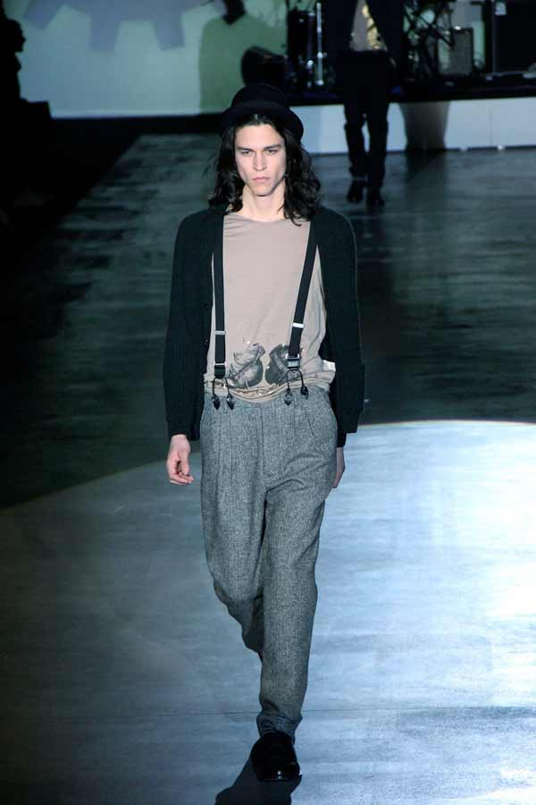 Fashion label Iceberg shows of its suspenders at a catwalk in 2013.