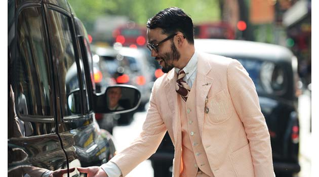 Guy in Linen Suit grabbing a London Taxi