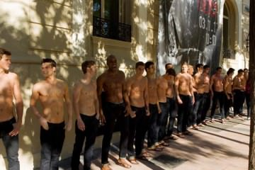 Abercrombie & Fitch - Staff lining up showing their muscles.