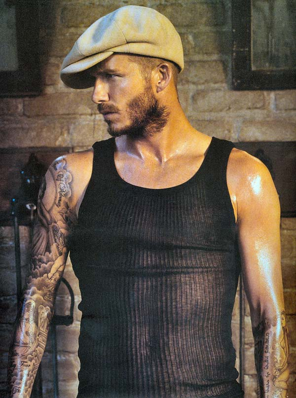 David Beckham Master of the modern Tattoo and wearing a hat