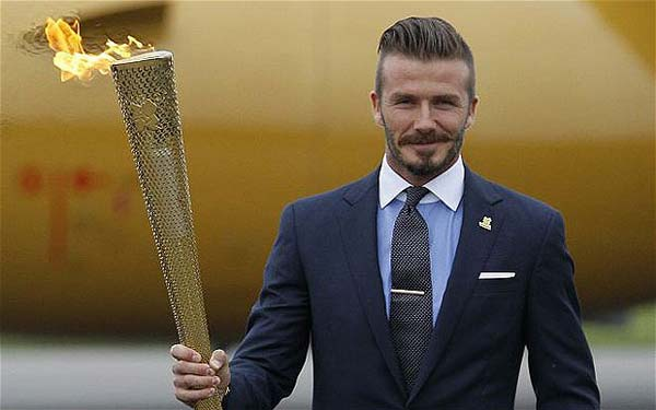 David Beckham as the Olympic ambassador wearing the Torch