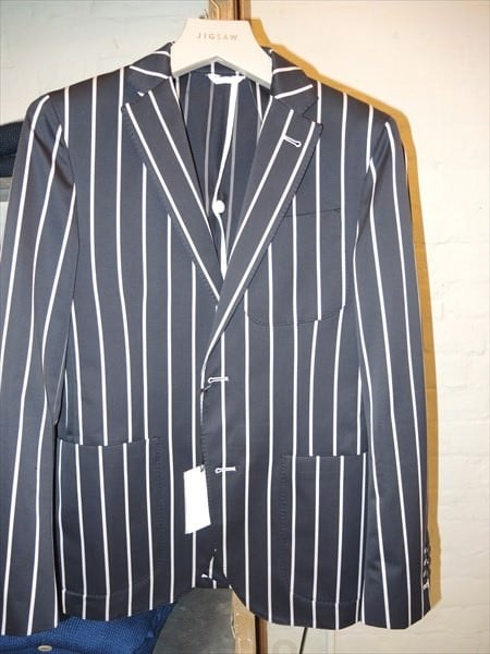 Double-breasted blazer in a striped weave with notch lapels, jetted front pockets and decorative buttons at the cuffs. Lined.