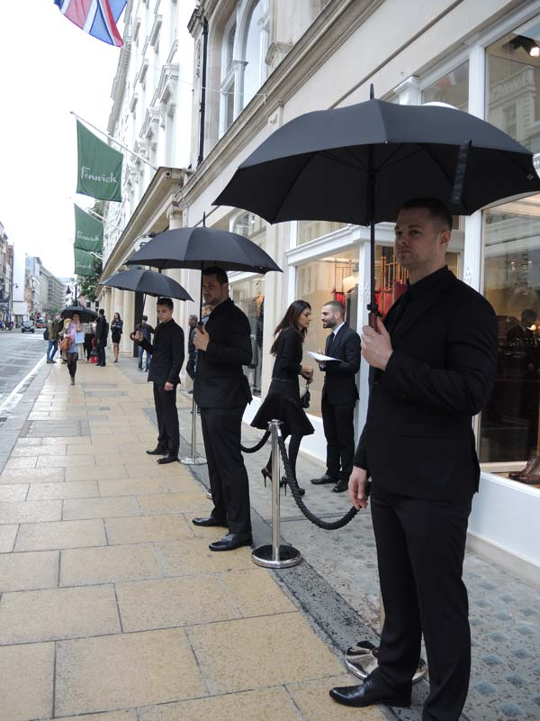 Dolce & Gabbana Menswear Store Opening in Bond street London - security wearing D&G suits