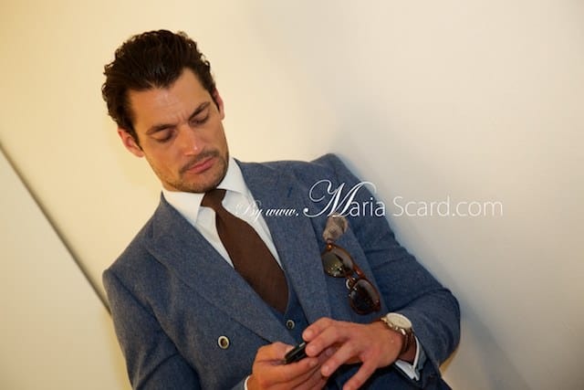 David Gandy in blue suit at London Collections Men event - checking his mobile