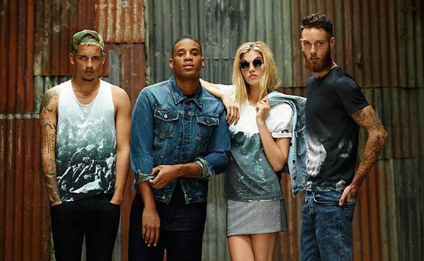 Reggie-Yates Burton Collection T--Shirts. wearing a jean jacket