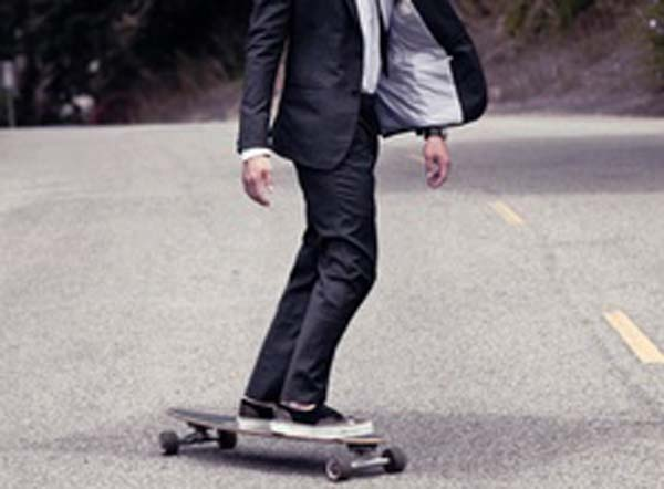 Suit and a guy on a skateboard with trainers