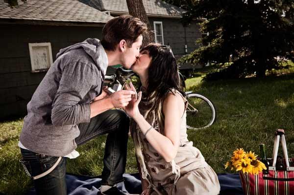 man proposing at a picnic