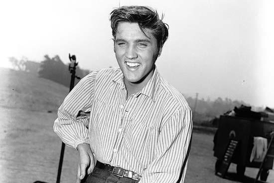 Elvirs Presley wearing a stripped shirt