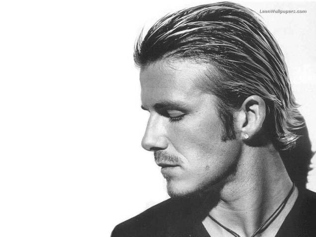 David Beckham With Long Hair And Diamond Earrings