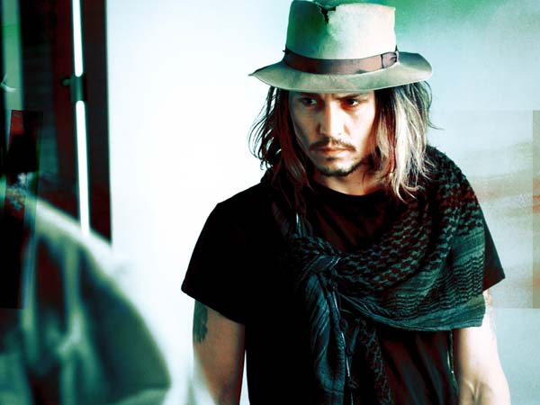 johnny depp wearing his favourite fedora hat
