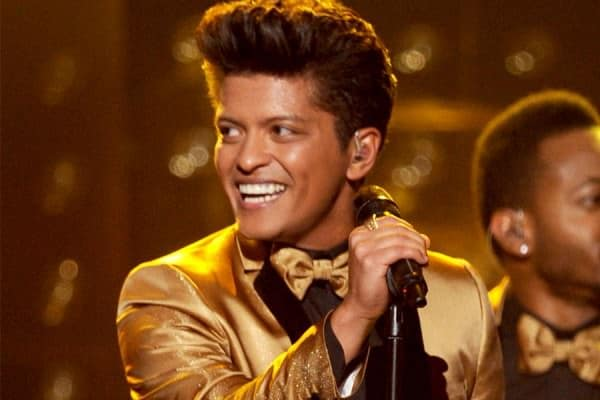 Bruno Mars wearing a gold suit