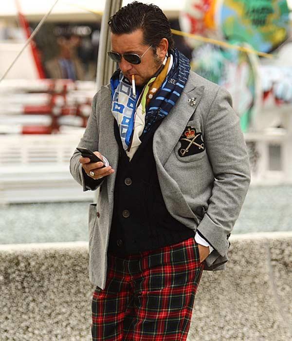 Man dressed in Tartan trousers
