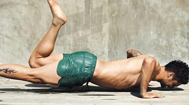 Olivier Giroud posing in a dedicated Gay mangazine