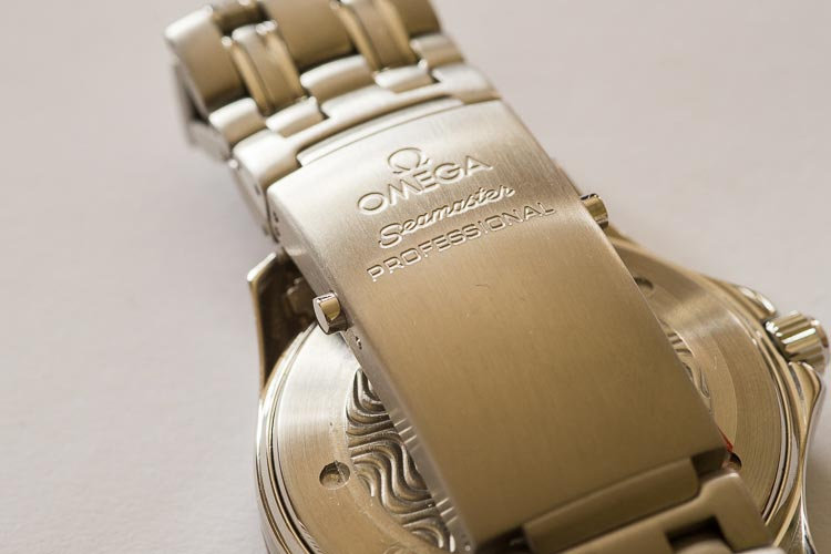 """The iconic Seamaster buckle, now without a myriad of scratches"" Omega"